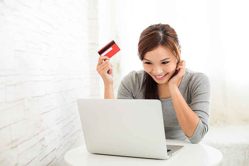 Woman-enjoy-online-shopping-paying-by-credit-card