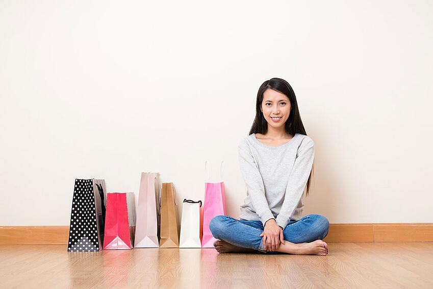 Woman-with-shopping-bag-in-home