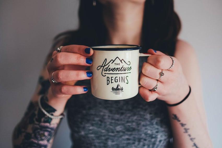 Social influencer holding mug