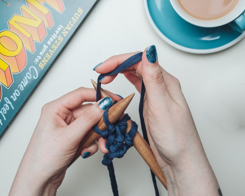 young gen y woman knitting