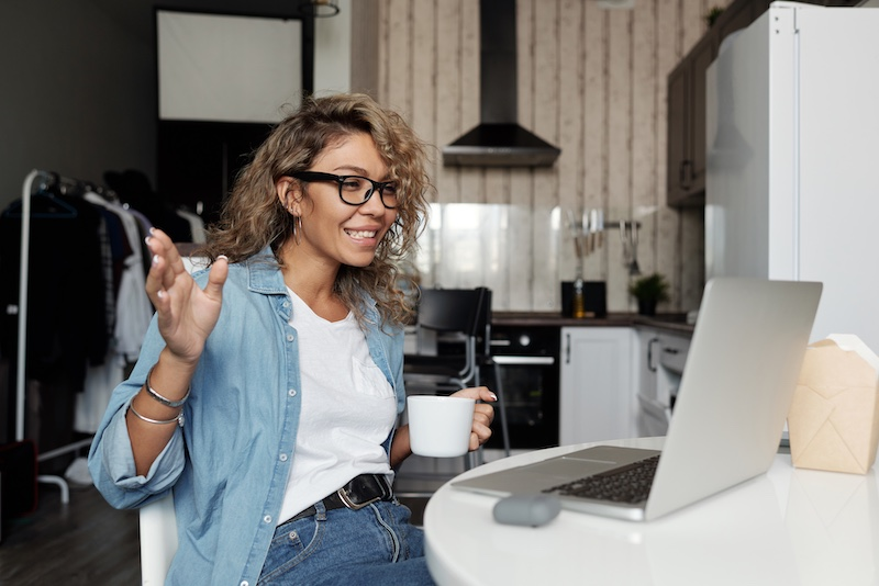 woman trying new drink over video research interview